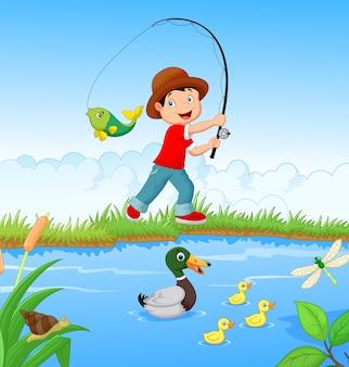 Kleine jongen vissen