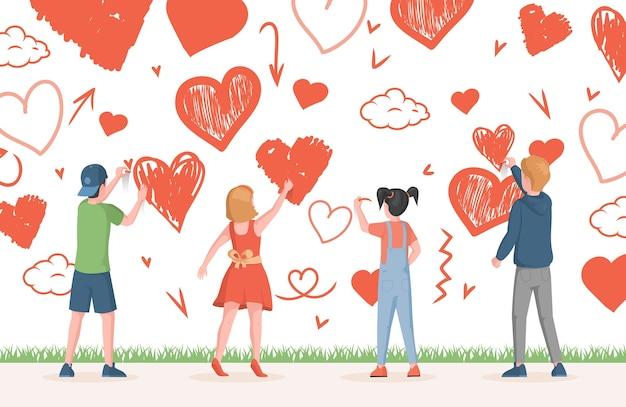 Kleine jongens en meisjes tekenen harten en liefdesymbolen op de muur