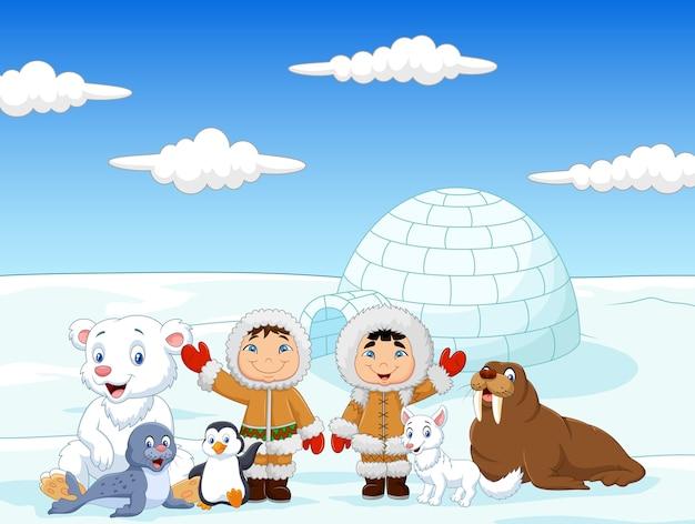 Kleine kinderen dragen traditioneel eskimokostuum