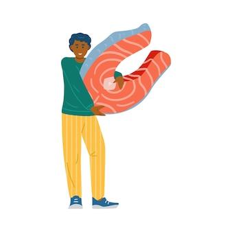 Kleine man met een stukje zalmvis op wit