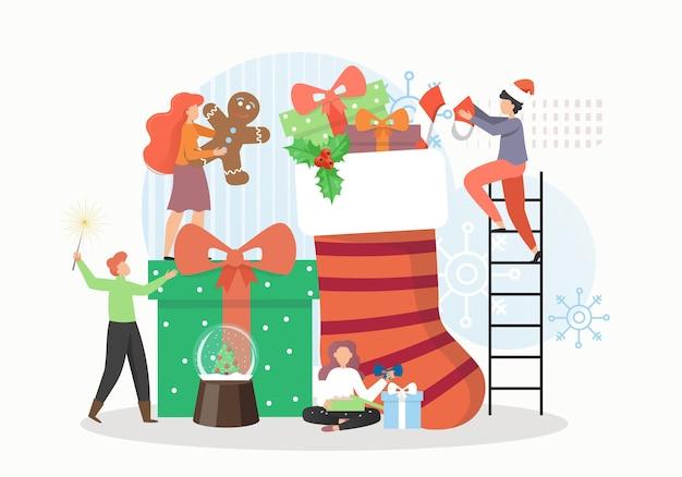 Kleine mannelijke en vrouwelijke karakters die traditionele kerstcadeautjes voorbereiden