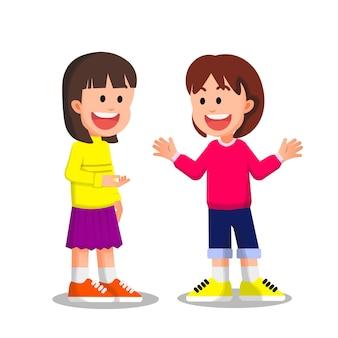 Kleine meisjes die truien dragen, maken samen een praatje