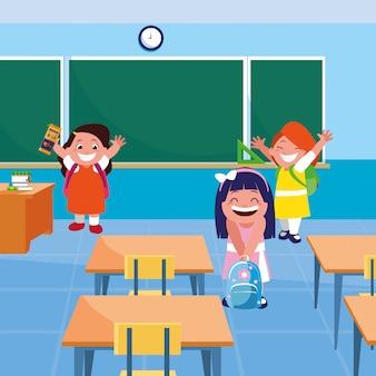 Kleine studentenmeisjes in de klas