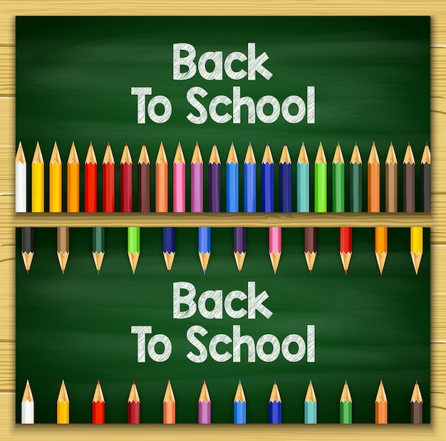 Kleurpotloden op schoolbord achtergrond