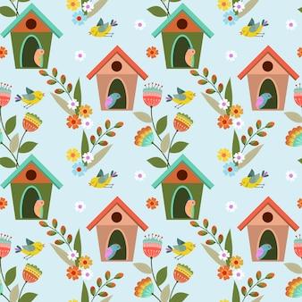 Kleurrijk vogels en vogelhuisjes naadloos patroon.