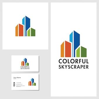 Kleurrijk wolkenkrabber logo ontwerp met visitekaartje mockup