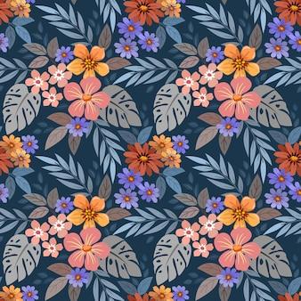 Kleurrijke bloemen op donkerblauw naadloos patroon als achtergrond