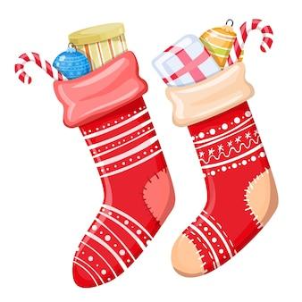 Kleurrijke cartoon illustratie van kerst sokken met cadeautjes op witte achtergrond