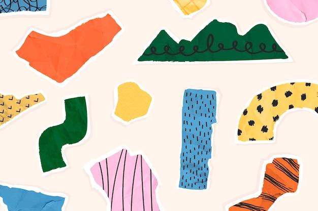 Kleurrijke gescheurde papieren patrooncollage op beige achtergrond