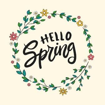 Kleurrijke hallo lente belettering met florale frame