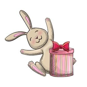 Kleurrijke handtekening bunny met een cadeautje op een witte achtergrond.