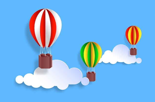 Kleurrijke hete lucht ballonnen op de wolk met papier knippen stijl