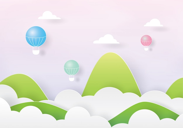 Kleurrijke hete luchtballons die over de wolk en de berg vliegen