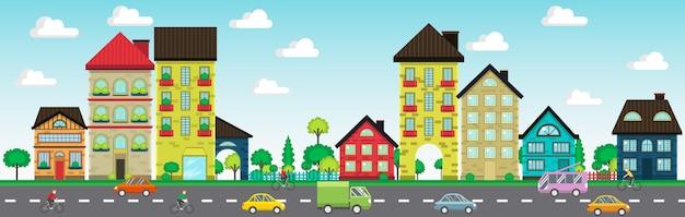 Kleurrijke huizen aan de straat met auto's en