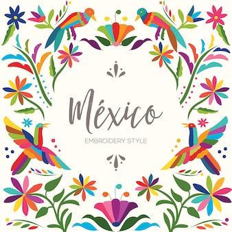 Kleurrijke mexicaanse traditionele textielborduurstijl uit tenango, hidalgo; méxico - kopieer de ruimte bloemensamenstelling met vogels