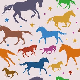 Kleurrijke paarden silhouetten naadloze patroon