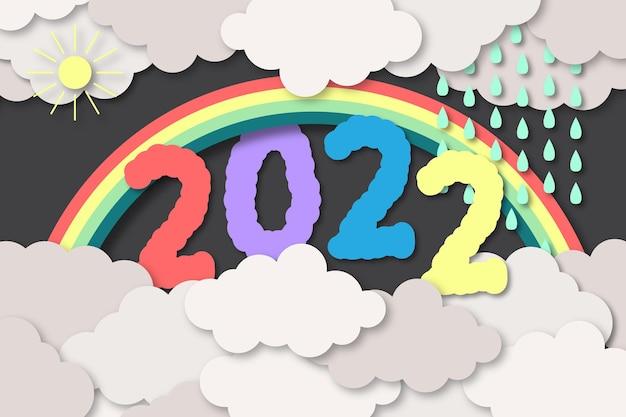 Kleurrijke papercut-stijl uit 2022 met wolkenachtergrond
