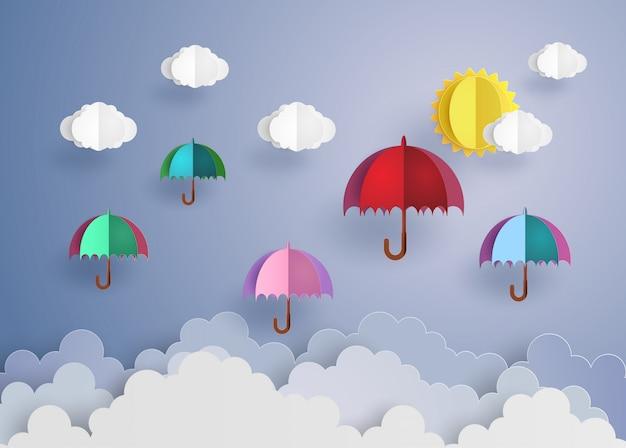 Kleurrijke paraplu's vliegen hoog in de lucht.