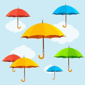 Kleurrijke paraplu's vliegen in de lucht. plat ontwerp