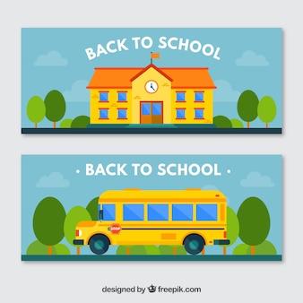 Kleurrijke spandoeken met de school en de school bus