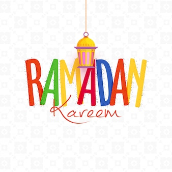 Kleurrijke tekst ramadan met hangende lantaarn