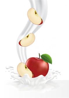 Kleurrijke verse appel die in de melkachtige plons valt