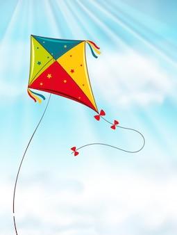 Kleurrijke vlieger die in blauwe hemel vliegt