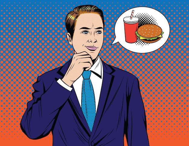 Knappe kerel die in kostuum over snel voedsel denkt