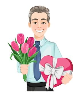 Knappe man met een boeket tulpen