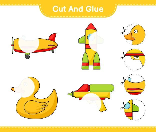 Knip en lijm gesneden delen van plane rocket rubber duck water gun en lijm ze