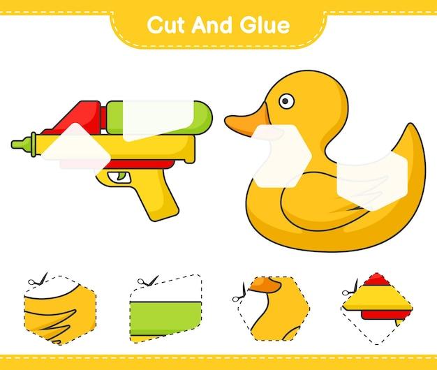 Knip en lijm gesneden delen van rubberen eend en waterpistool en lijm ze educatief kinderspel