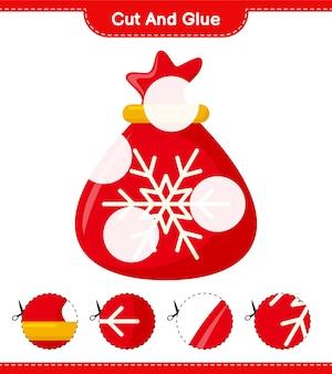 Knip en lijm, knip delen van de kerstmanzak uit en plak ze vast. educatief kinderspel, afdrukbaar werkblad