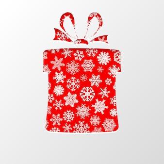Knip het papier uit in de vorm van een geschenkdoos voor kerstmis, met witte sneeuwvlokken op een rode achtergrond