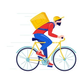 Koerier met beschermend masker bezorgt goederen en eten op de fiets online bezorging contactloze service