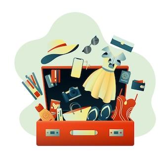 Koffer met kleding en accessoires voor op reis Premium Vector