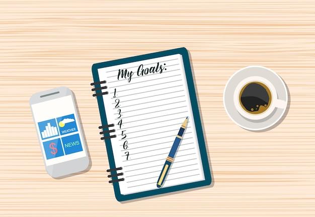 Koffie en lege memo met smartphone.