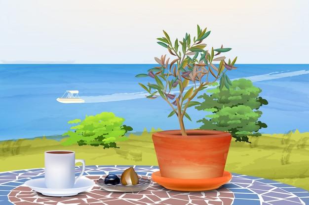 Koffie en olijfboom aan zee