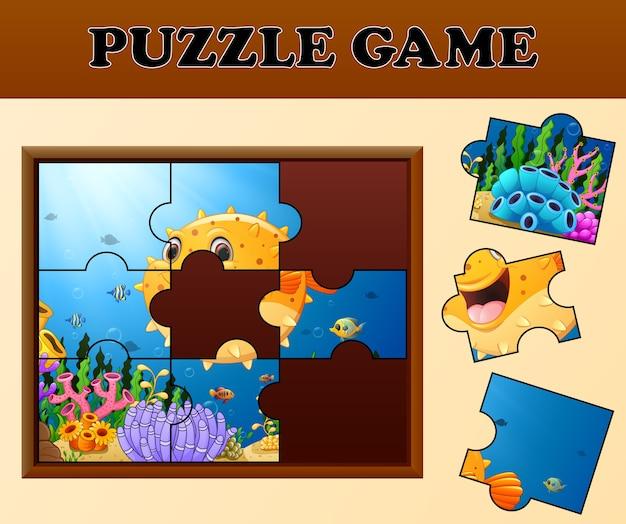 Kogelvissen in onderzeese met puzzel concept
