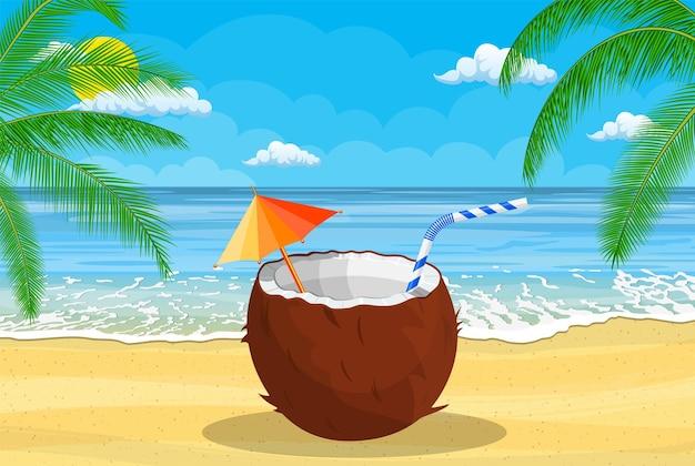 Kokosnoot met koude drank, alcoholcocktail in de hand.
