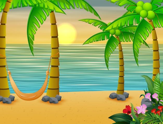 Kokospalmen met schommelbed op het strand