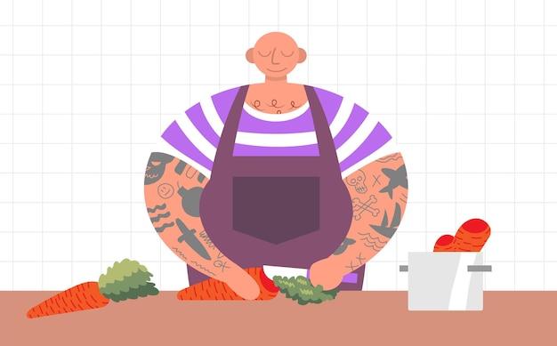 Kookproces met chef-kok een grote en sterke man met tatoeages snijdt mes wortel food blogger