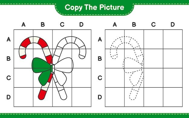 Kopieer de afbeelding, kopieer de afbeelding van candy canes met lint met behulp van rasterlijnen. educatief kinderspel, afdrukbaar werkblad