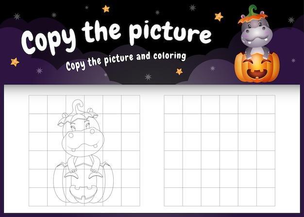 Kopieer het foto-kinderspel en de kleurpagina met een schattig nijlpaard met een halloween-kostuum