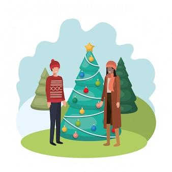 Koppel met kerstboom in landschap
