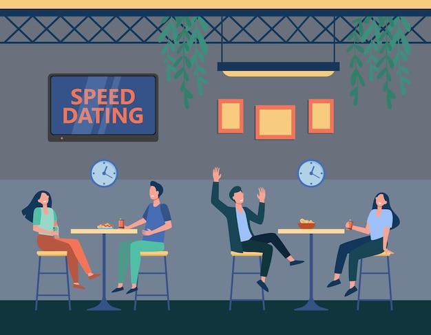 Koppels in café op speeddatingprogramma