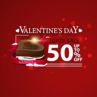 Korting rode banner voor valentijnsdag met chocoladesuikergoed