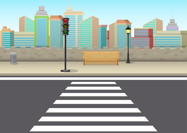 Kruispunt met verkeerslichten en wolkenkrabbers op de achtergrond