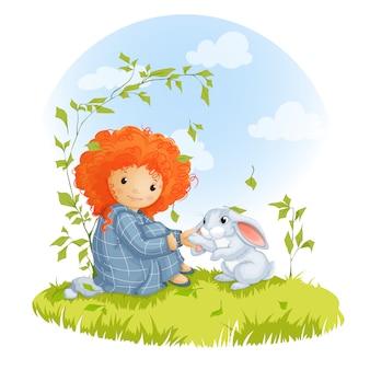 Krullend roodharig meisje en hazen zittend op een weide.