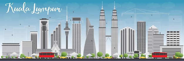 Kuala lumpur skyline met grijs gebouwen en blauwe hemel.