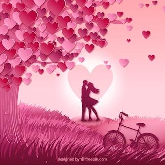 Kussend paar in een weide